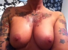 rubbing my oiled up tits
